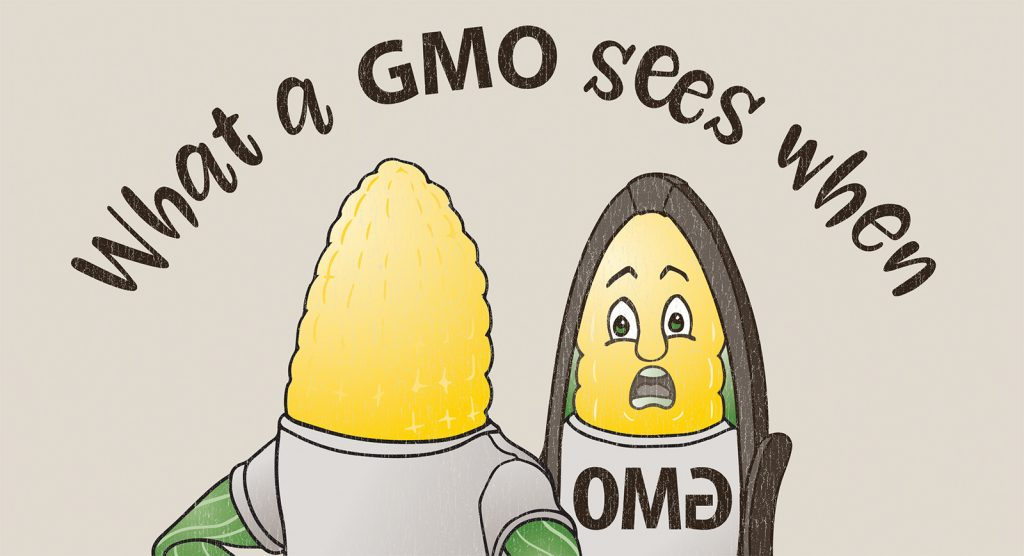 A B2B trade show t-shirt showing a GMO corn ear judging itself in the mirror.